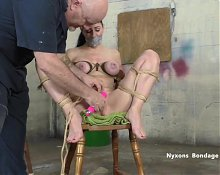 Busty woman stripped, gagged, tied and vibed