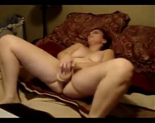 Mature wife masturbating while watching porn
