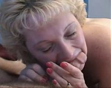 Busty grandma gives a blowjob